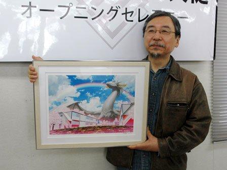 開業にあたって寄贈したイラストと開田裕治さん=2014年4月17日、大槌町吉里吉里1丁目