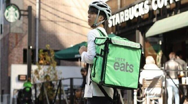 いまや街で見かけないことがないUber Eats(写真はウーバー・ジャパンのホームページから)