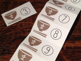 「まかないプロジェクト」のロゴが入った回数券でランチやディナーが味わえる