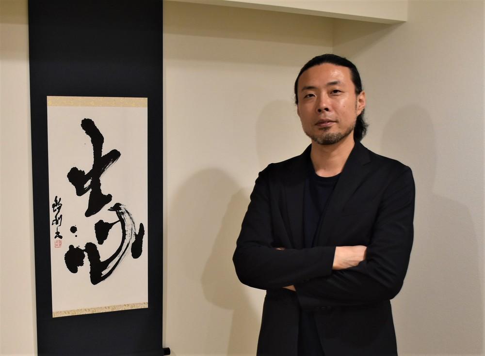 書家でもある前田さん。「余白」の使い方などはプレゼンに役立ったという