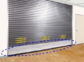文化シヤッター、青色の点線で囲んだ部分がシャッター下部に連結された耐火クロススクリーン