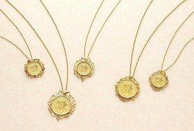 「宝石の花束」「オーストリアの村つばめ」「エリザベート」をテーマにしたコインペンダント