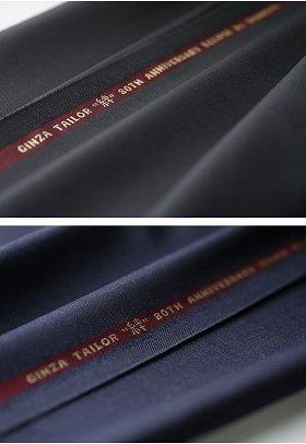 銀座テーラーが「ドーメル」とコラボして発売したスーツ。上が「エクリプス(ECLIPS)」で下が「アイコニック(iconik)」。それぞれ「絆」の文字が入っている